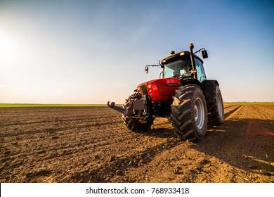 Farmer fertilizing arable land with nitrogen, phosphorus, potassium fertilizer