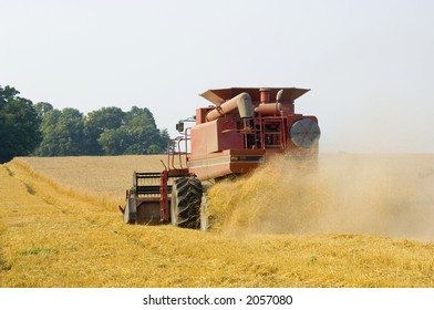 A farmer harvests wheat in a field in central Illinois