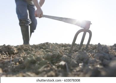 farmer hoeing