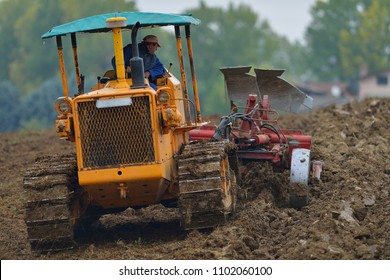 farmer with large crawler tractor