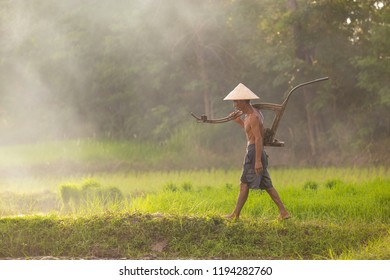 Farmer man in the field, to do farming in the rainy season.