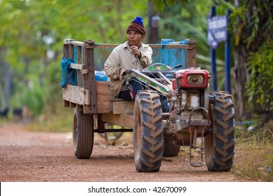 farmer on his small tractor on the countryside in thailand