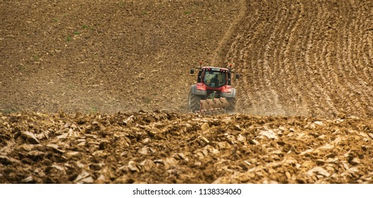 Farmer on tractor plow field, France, Europe