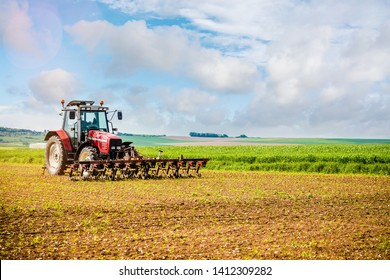 farmer passing the harrow in his fields