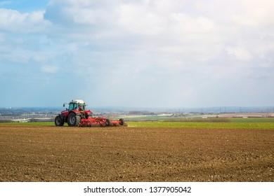 farmer plowing his fields