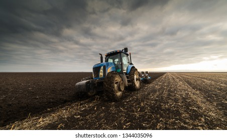 Farmer plowing stubble fields