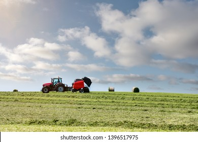 farmer preparing haystacks in pastures