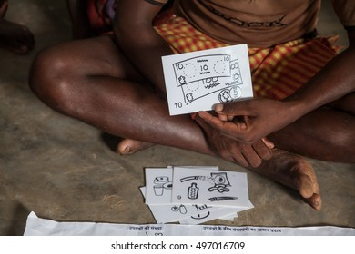 A farmer shows a record card representing money, Jharkhand, India