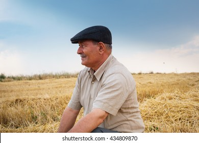 Farmer sitting in the field, waiting for his crop