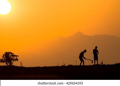 farmer and son silhouette