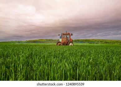 Farmer spraying his fields