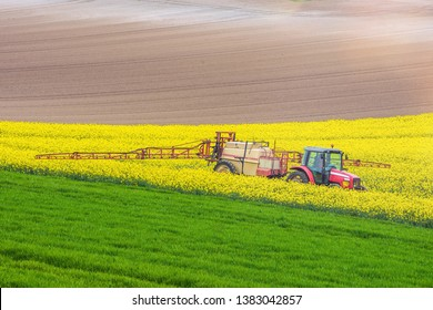 farmer spraying oilseed rape fields