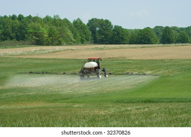 A farmer sprays grass killer on his crop in preparation of planting corn.