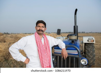 Farmer standing with Tractor