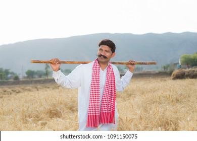 Farmer standing in the wheat field