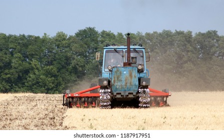 Farmer in tractor preparing land with sowing seedbed cultivator
