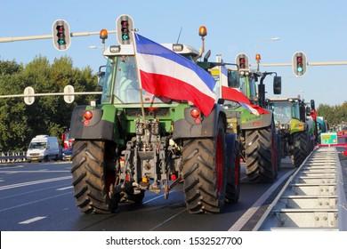 Farmer tractors with Dutch flag on highway to The Hague, protest demonstration against RIVM nitrogen emission measurement, livestock shrinking, government policy, De Bilt, Netherlands