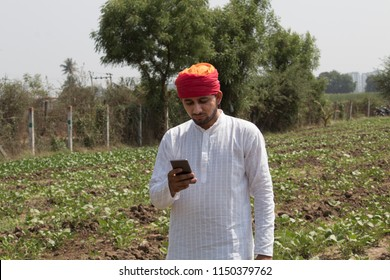 Farmer using mobile phone