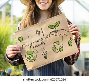 Farmer woman holding go green banner