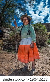 Farmer woman takes a break for the photo. October 13, 2012, Caraz Peru.
