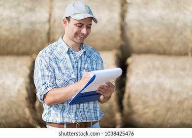 Farmer writing on a document