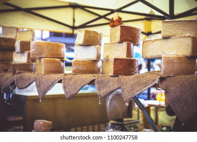 Farmers cheeses in the city market in Basel. Low shallow focus. Toned