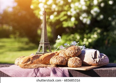Farmers food products: milk, bread, baguette. Composition captured from above with parisian eiffel tower. Country lifestyle, paris vacation or organic food concept.