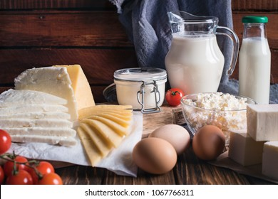 Farmers food products: milk, cream, cheese, eggs, cottage butter Rustic composition Organic food concept