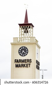 Farmer's market tower with clock on the wall