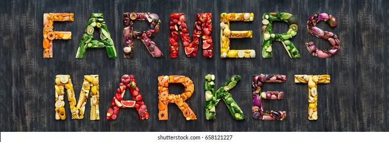Farmers market word from overhead flatlay  colourful multi-colored fruits and vegetables veggies fresh produce organic harvest