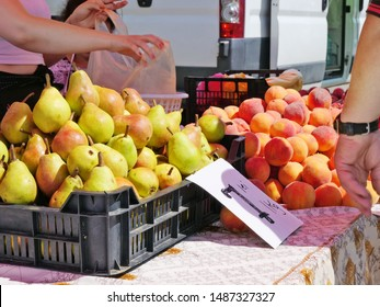 Farmers sell summer pears and apricots at the Sunday market at seven Romanian lei per kilogram.