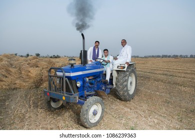 Farmers sitting on tractor