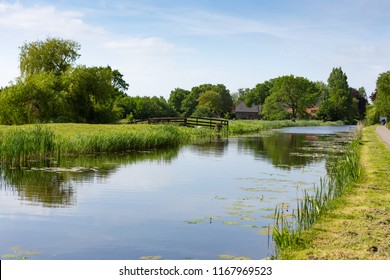 Farmhouse on the water in the Dutch village of Nieuwe Wetering in The Netherlands
