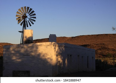 farmhouse with a wind pump in the karoo South Africa