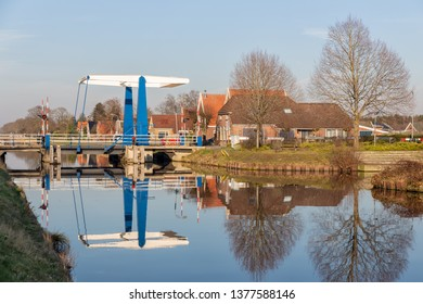 Farmhouses and drawbridge over canal near Smilde in Drenthe, The Netherlands