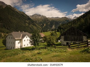 Farmhouses with Fence and Mountains in the Background in Summer, Mallnitz, High Tauern, Alps, Austria, Europe