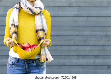 Farming, gardening, harvesting, fall and people concept - woman with apples at autumn garden