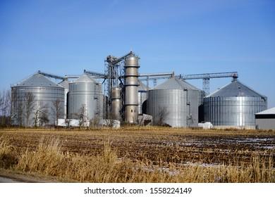 Farming grain elevator on farmland