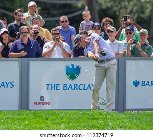 FARMINGDALE, NY - AUGUST 21: Long Hitting Dustin Johnson hits a drive at Bethpage Black during the Barclays on August 21, 2012 in Farmingdale, NY.