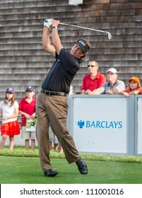 FARMINGDALE, NY - AUGUST 21: Phil Mickelson hits a drive at Bethpage Black during the Barclays on August 21, 2012 in Farmingdale, NY.