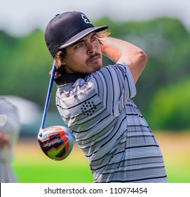 FARMINGDALE, NY - AUGUST 21: Rickie Fowler hits a drive at Bethpage Black during the Barclays on August 21, 2012 in Farmingdale, NY.