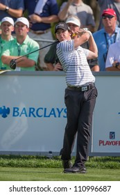 FARMINGDALE, NY - AUGUST 21: Rory McIlroy hits a shot on Bethpage Black at the Barclays on August 21, 2012 in Farmingdale, NY.