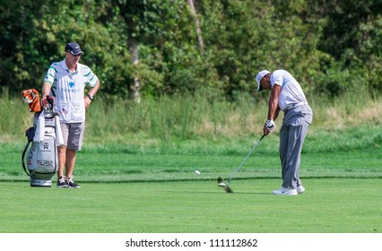 FARMINGDALE, NY - AUGUST 22: Tiger Woods hits a hot at Bethpage Black during the Barclays on August 22, 2012 in Farmingdale, NY.