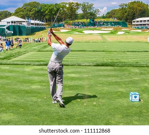 FARMINGDALE, NY - AUGUST 22: Tiger Woods hits a tee shot off the 17th hole at Bethpage Black during the Barclays on August 22, 2012 in Farmingdale, NY.