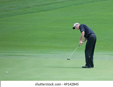 FARMINGDALE, NY - JUNE 15: Jim Furyk putts on the 12th hole on the Black Course during the 2009 US Open on June 15, 2009 in Farmingdale, NY.