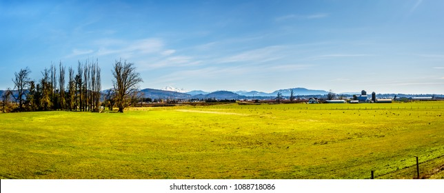 Farmland near the Matsqui Dyke at the towns of Abbotsford and Mission in British Columbia, Canada with Mount Baker in the background