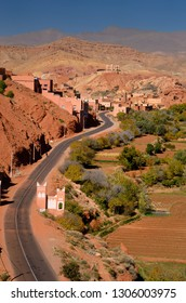 Farmland and red rock hills along road in Dades Gorge in the High Atlas mountains Morocco