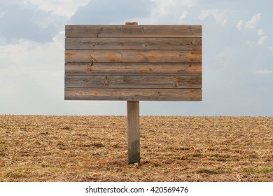 farmland and Wooden sign