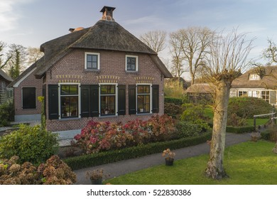 Farms with thatched roofs at the beautiful canals with wooden bridge at they end of autumn,Giethoorn Holland Overijssel Netherlands November 2016