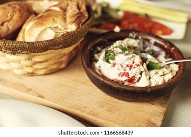 farm-style country lunch, traditional Albanian cuisine dish with cheese and bread